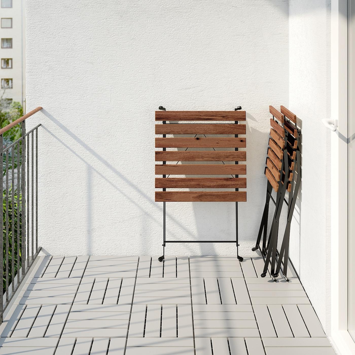 TÄRNÖ Table+2 chairs, outdoor - black/light brown stained/Kuddarna grey -  IKEA