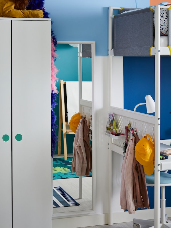 At the end of a VITVAL loft bed, a dressing corner is created with a NISSEDAL mirror and a pegboard for accessories.