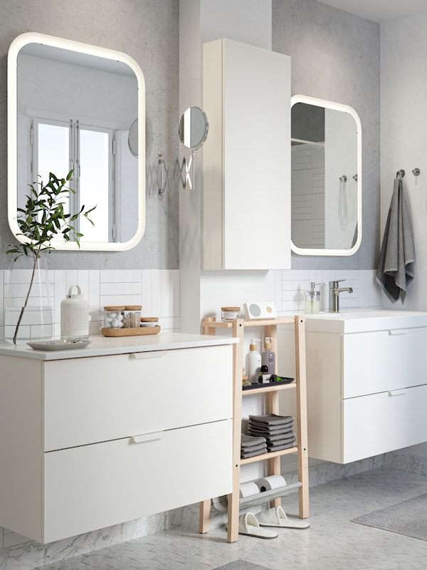 An image showing a white bathroom next to a blue background with text about the IKEA bathroom planner.