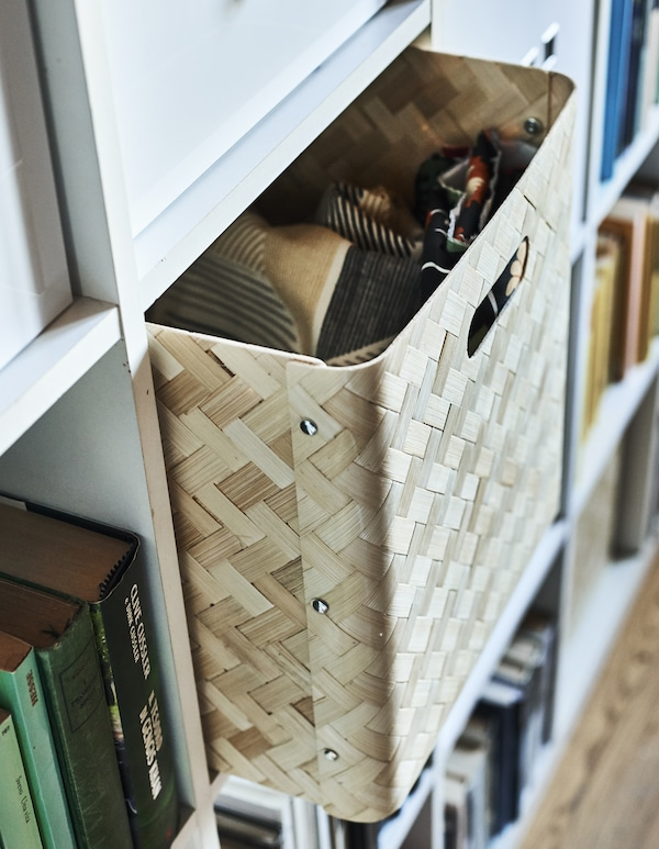 A bamboo box insert in a cubed storage unit.