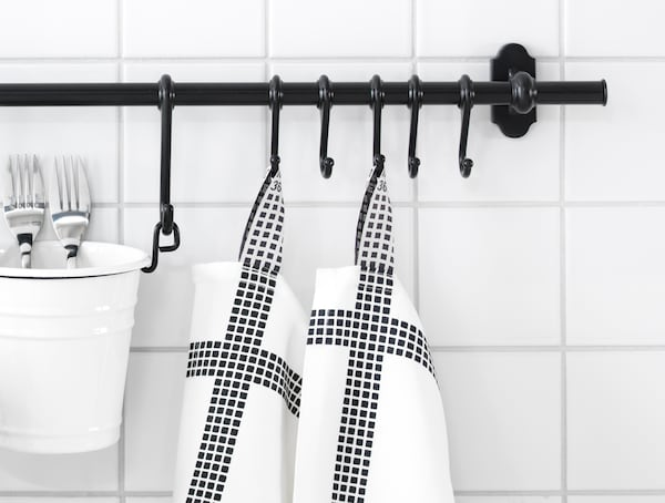 A bucket and some towels hanging from INTORP kitchen organiser series.
