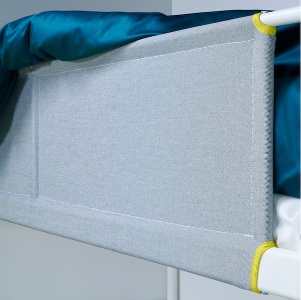 A close-up of the fabric guard rail in grey, part of VITVAL bunk and loft beds.