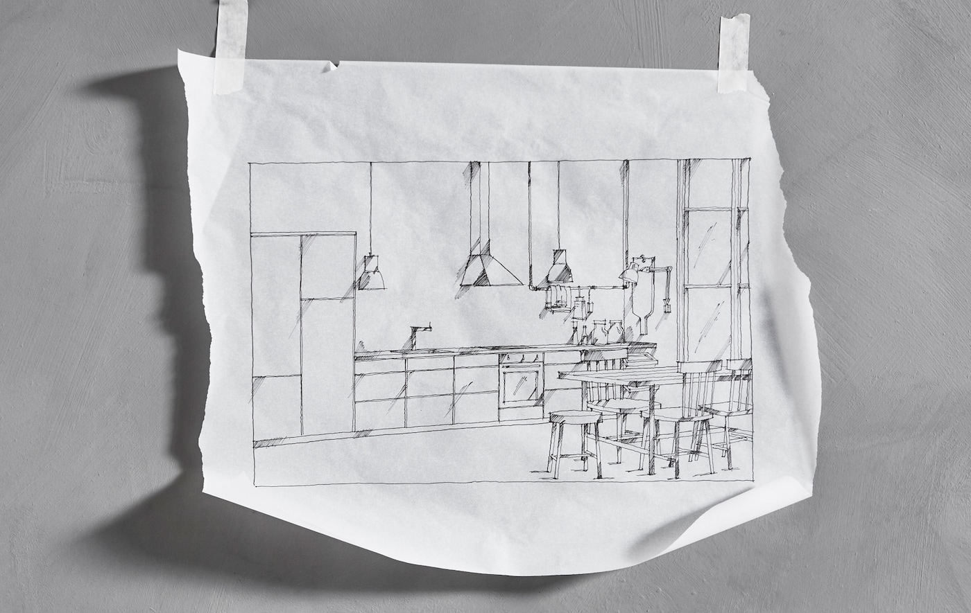 A hand-drawn sketch of a straight-line IKEA kitchen that's taped to a wall