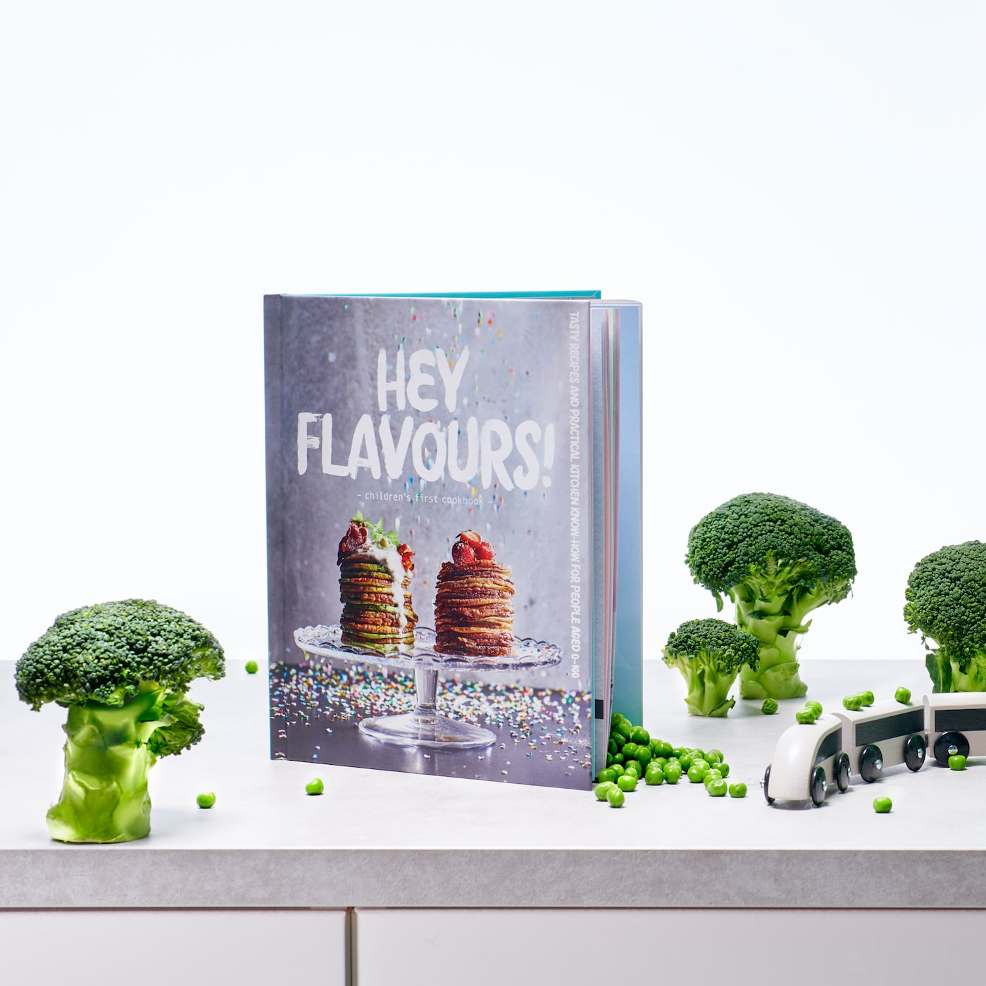 A MATVRÅ book Hey Flavours! with a cover featuring stacked pancakes on a cake stand with berries on top.