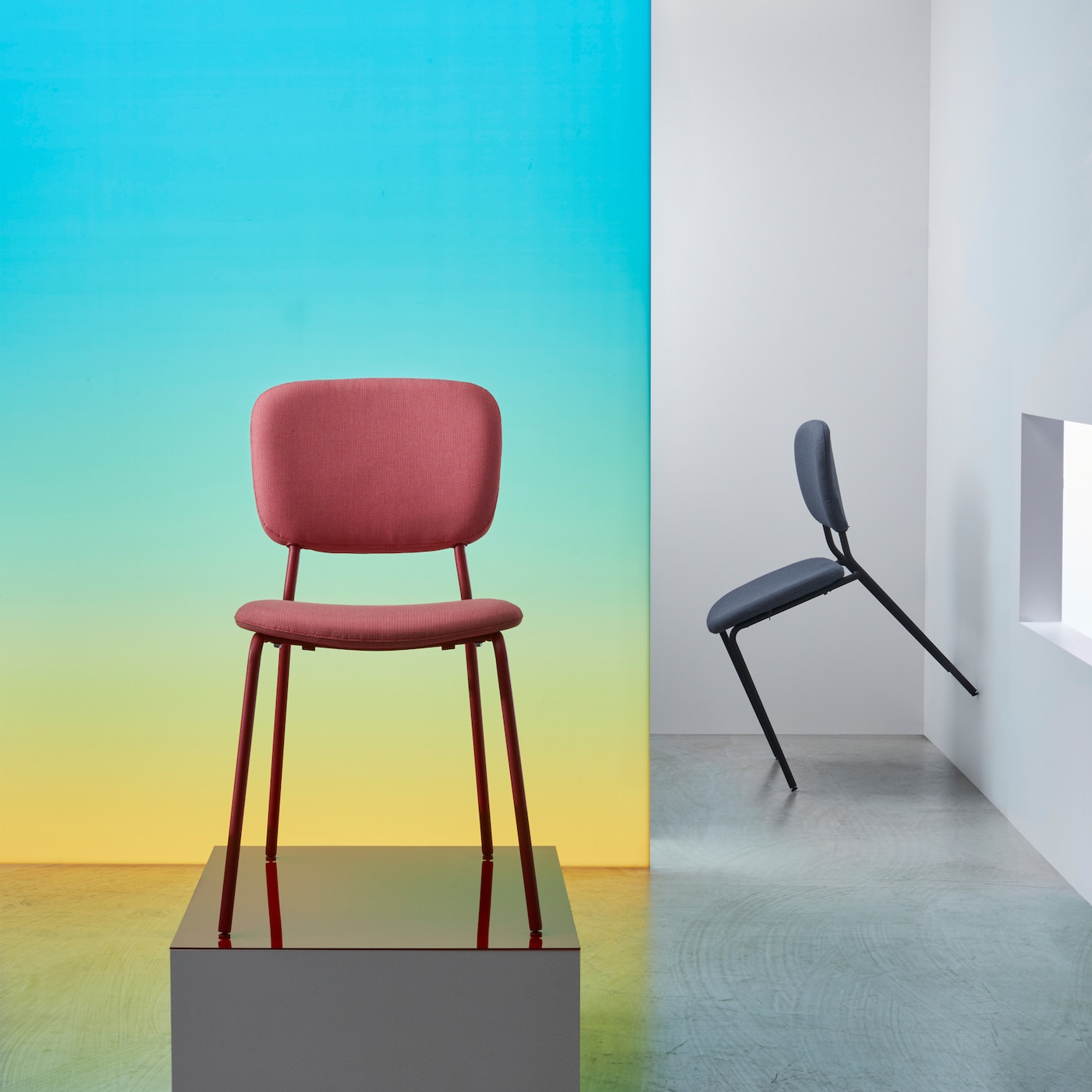 A red KARLJAN chair with an upholstered seat and backrest on a metal frame with a retro-inspired design.