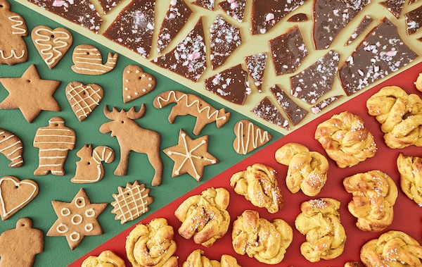 An aerial view of toffee pieces, gingerbread cookies and saffron buns