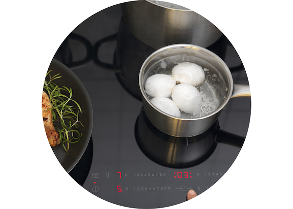 An IKEA Induction hob with an IKEA pot where eggs are boiling.
