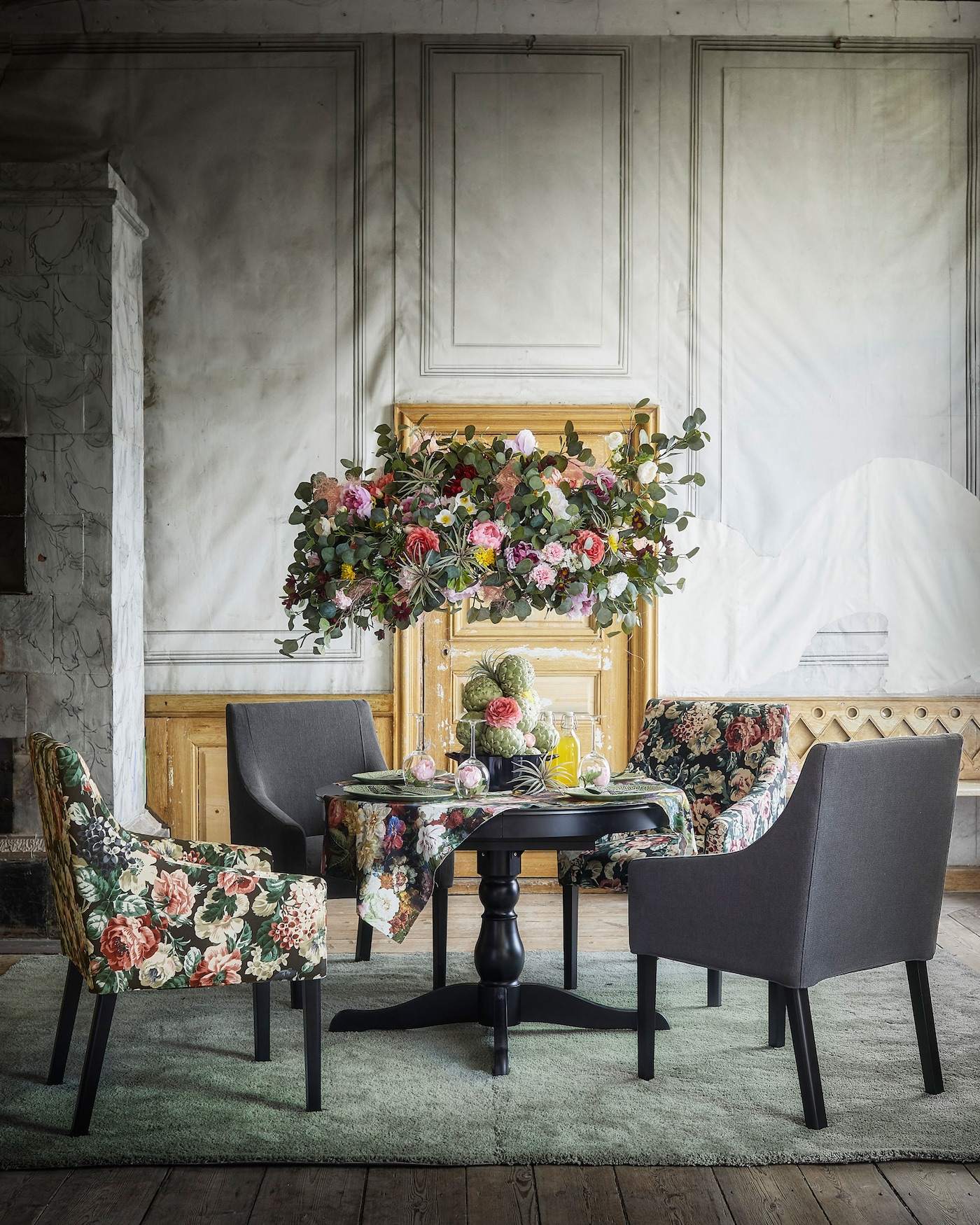 Available from IKEA in various covers like dark grey and a multicoloured floral pattern, SAKARIAS chair with armrests has a padded seat, lumbar support and low armrests that fit under the table.