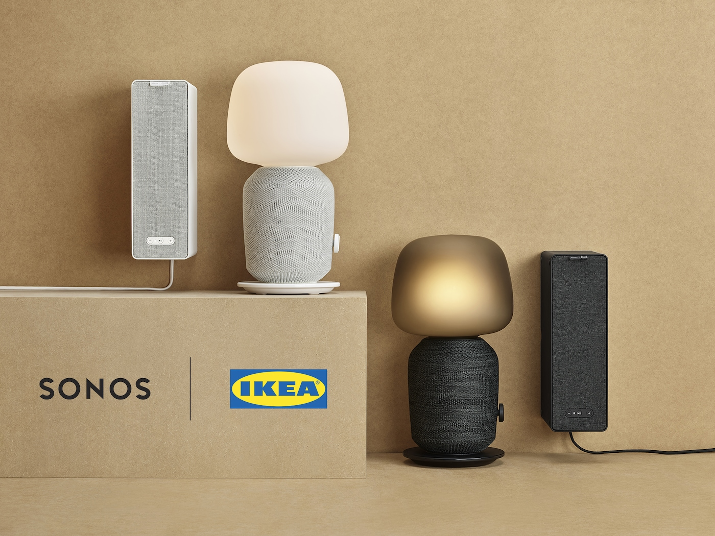 Black and white SYMFONISK table lamps, with built-in WiFi speakers and two vertically hung bookshelf speakers, created by SONOS and IKEA.