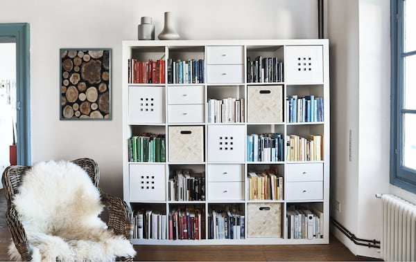 Books and box inserts in a large cubed storage unit.