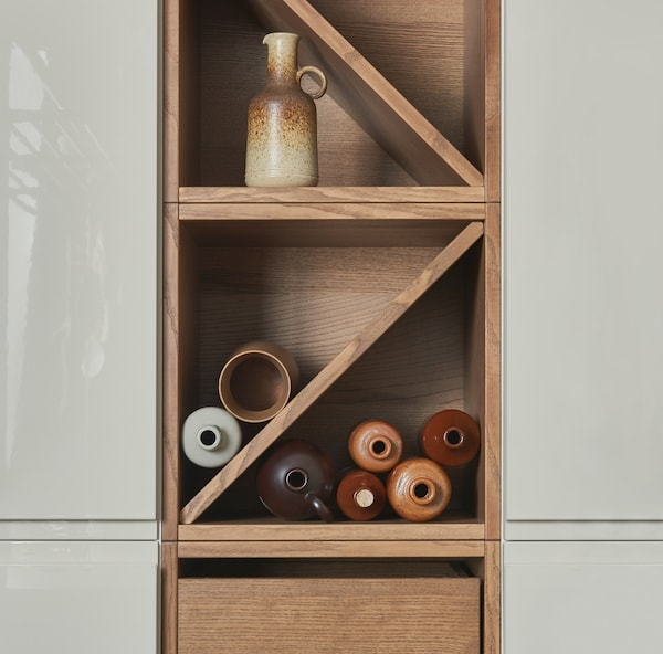 Bring in warmth to your home with the traditional-styled VADHOLMA wine shelf and drawer unit. This new VADHOLMA kitchen storage series is made of brown stained ash.