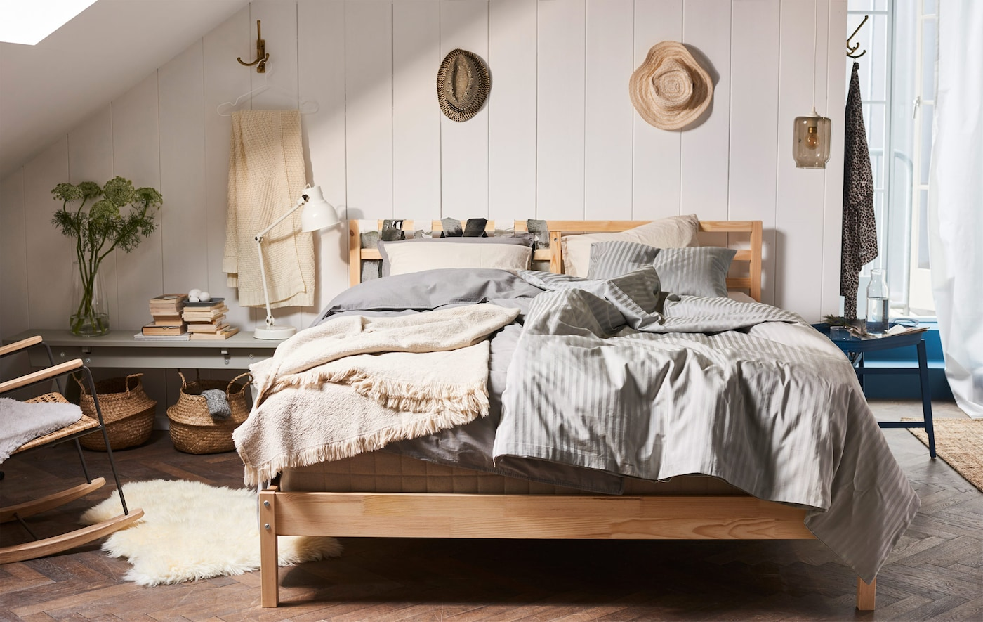 Create a modern bedroom with a minimalistic bed frame! Try IKEA TARVA bed frame which has a simple Scandinavian design in untreated wood.