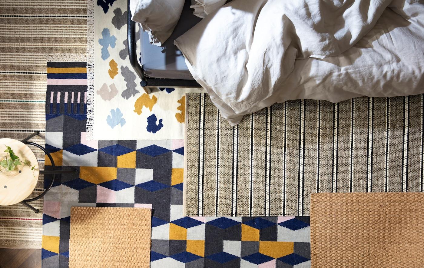 打造一间舒适的卧室在地板上铺几块地毯,减少回音。宜家有丰富多样的地毯,比如多色的 TÅRBÄK 托尔贝克 羊毛地毯。
