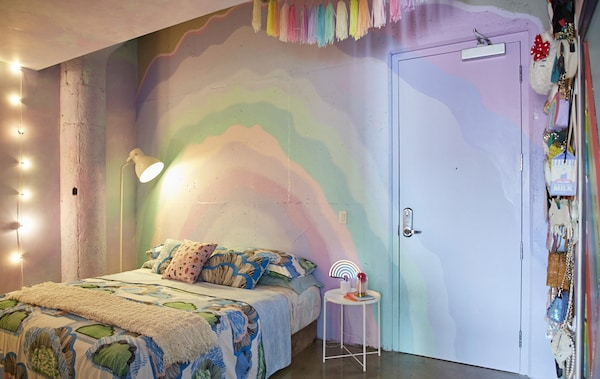 Decorate a bedroom with rainbow colours.