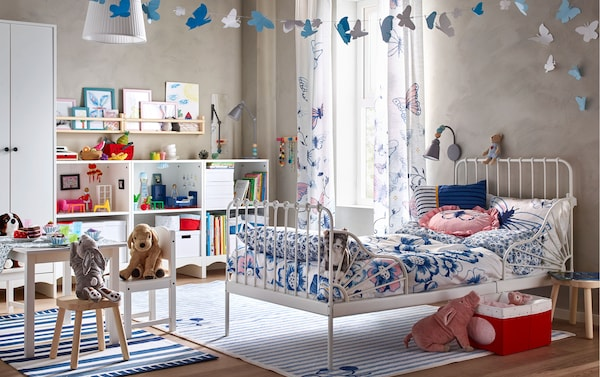 Decorate your children's bedroom with new blue and white SÅNGLÄRKA textile series, including floral bedsheets and semi-sheer curtains that have blue and pink butterflies.