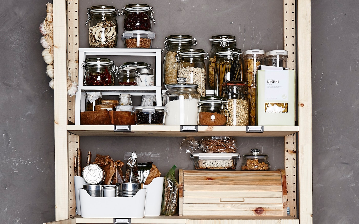 Dry goods are stored in glass jars.