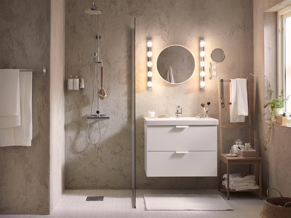 Evenly and functional lit bathroom supports the different activities taking place during the morning.