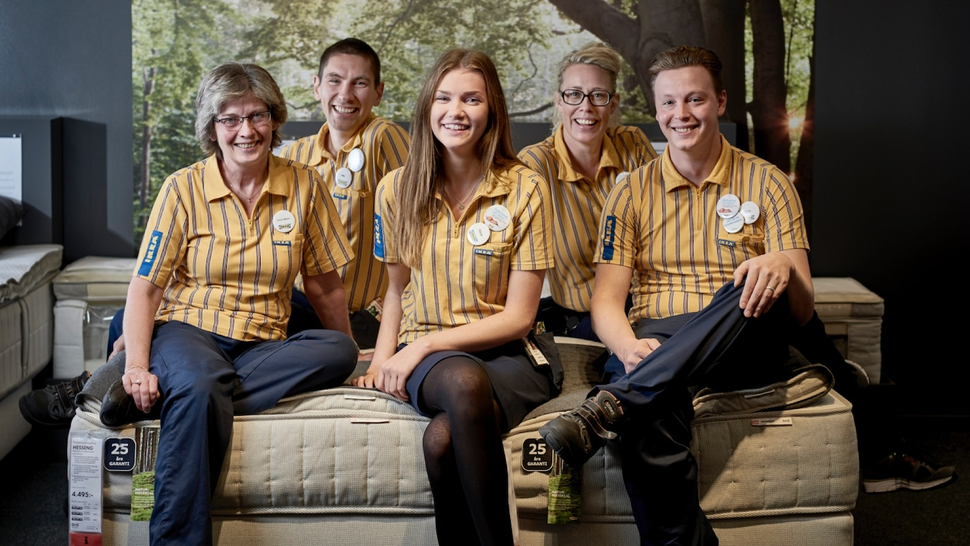 Five IKEA employees sit on the couch