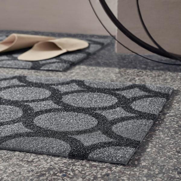 Grey MEJLS doormat with a circular pattern in dark grey.