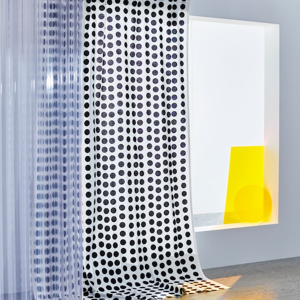 Hanging KLARASTINA curtains showing a pattern of black polka dots on a white background.