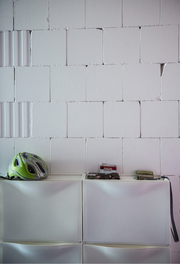 IKEA shoe cabinets on a white wall.