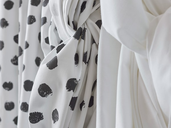 IKEA SKÄGGÖRT fabric with a black and white pattern is made from 100% more sustainable cotton.