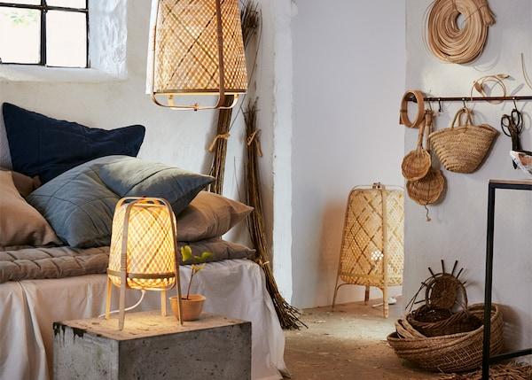 KNIXHULT table, floor and pendant lamps in a rustic bedroom.