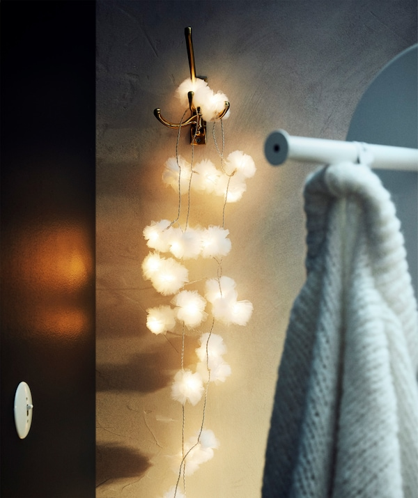 LIVSÅR LED lighting chain with 24 lights imbedded in white tulle is for indoor use only.