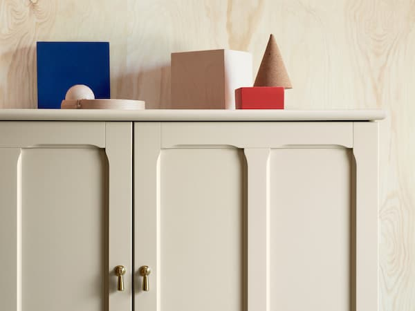 LOMMARP cabinet in beige with finely crafted details and drop handles for traditional-looking storage.
