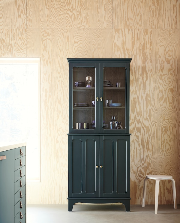 LOMMARP cabinet with glass doors in dark-blue green with crafted details for traditional-looking storage.