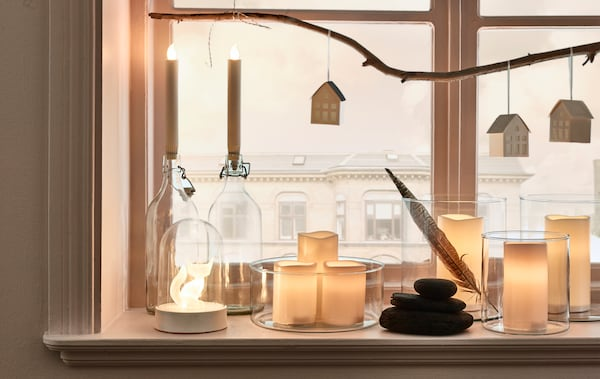 Looking for living room decoration ideas for the holidays? IKEA offers a lot of living room décor, such as LJUSANDE LED battery-operated candles or GODAFTON LED block candles, both in natural hues.