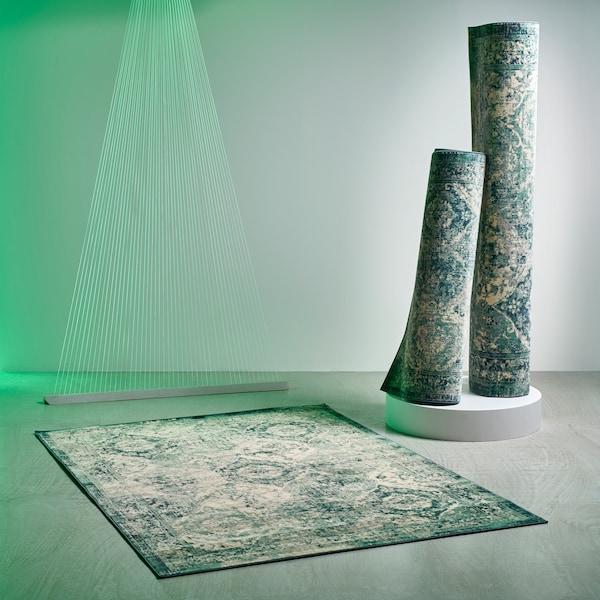 三块 VONSBÄK 翁斯拜克 地毯,印有仿旧复古的绿色调东方风情图案。