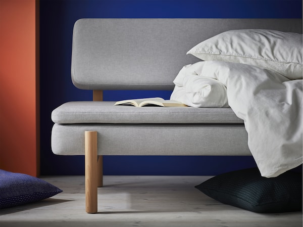 Sleep in style with the IKEA YPPERLIG sofa bed. A mattress is integrated into the couch's polyester-cotton blend, making it ideal for both parties and peace of mind.