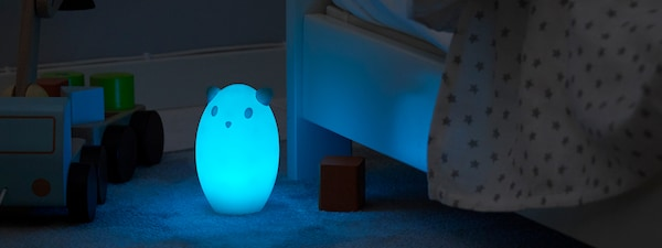 Soft illuminated parents and baby bedroom.