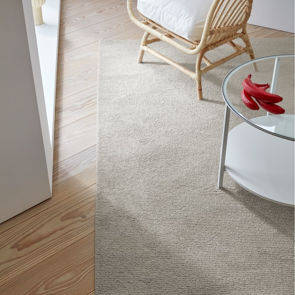 SPORUP rug in a rich beige colour made with a fine yarn that's densely tufted into a pile that's incredibly soft.
