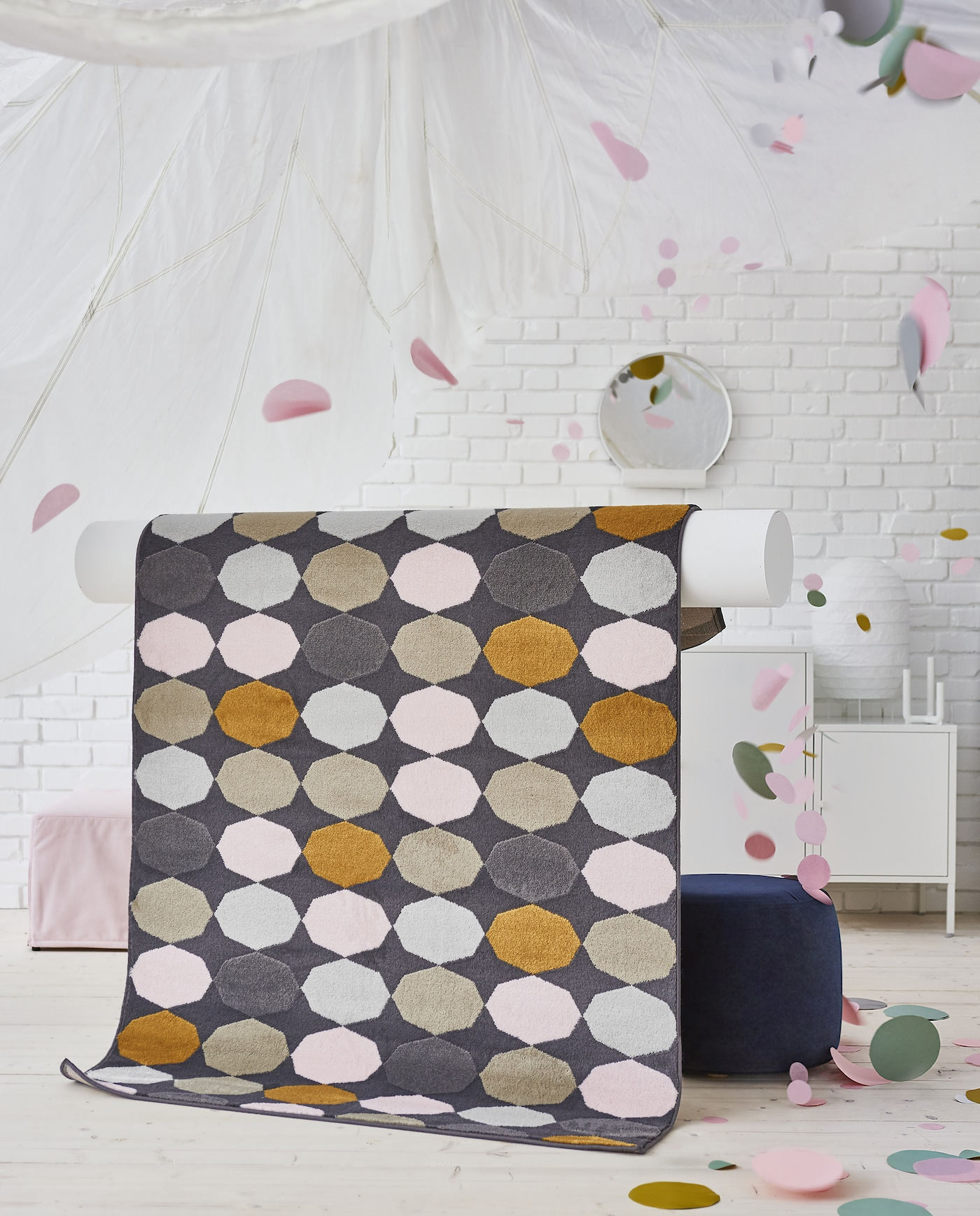 The affordable IKEA TORRILD rug has a playful, multicoloured pattern that adds personality to any room.