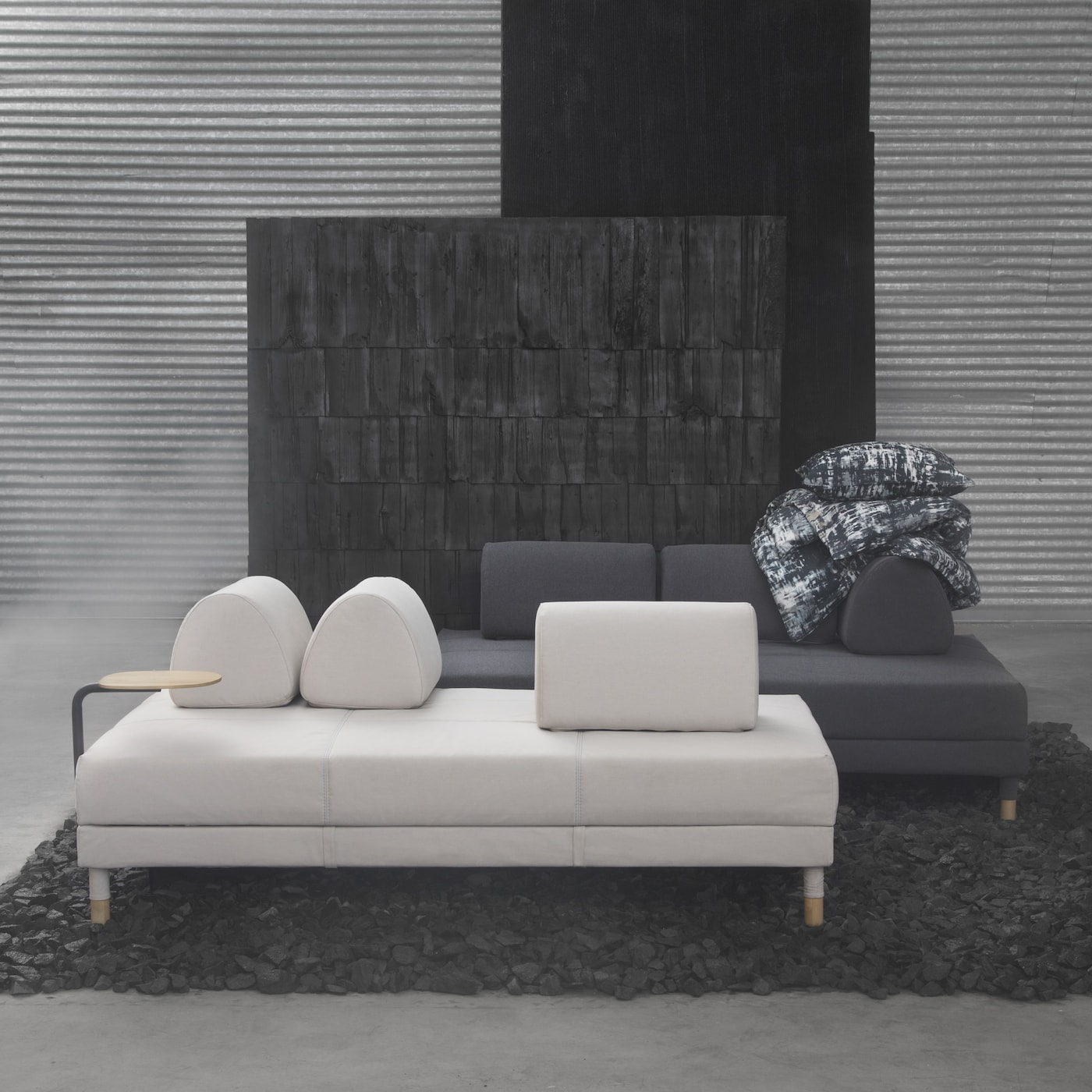 The cool, minimalist IKEA FLOTTEBO sofa-bed comes in beige, dark grey or green covers, you can even attach a small side table. The loose cushions of the sofa bed can be moved freely depending on how you want to sit or style the sofa.