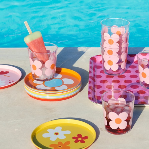 The IKEA SOMMAR 2019 glasses and trays with flower patterns in mixed colours puts you in vacation mode straight away.