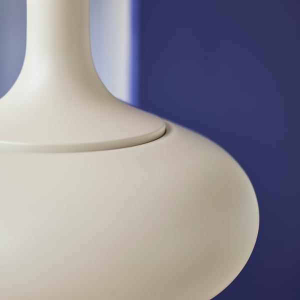 The IKEA VÄXJÖ pendant lamp has a simple, modern design with smooth rounded lines. It comes in beige.