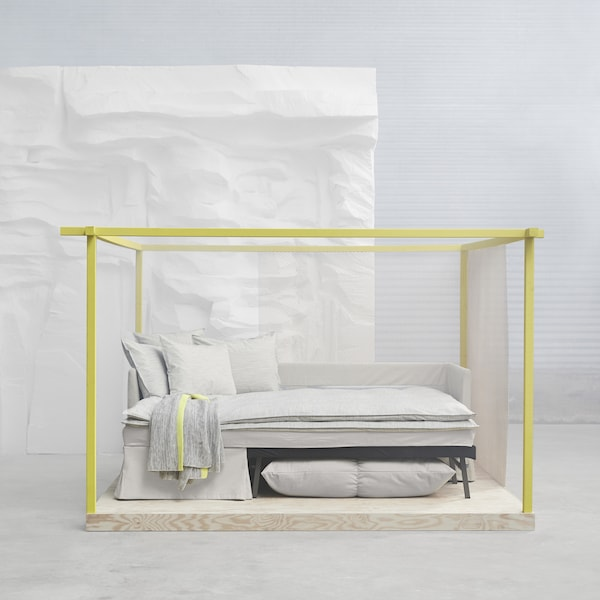 The neat IKEA SANDBACKEN corner sofa-bed in a beige or light grey cover, converts to a bed by pulling out the bed part, folding it up and combining it with the corner sofa part.