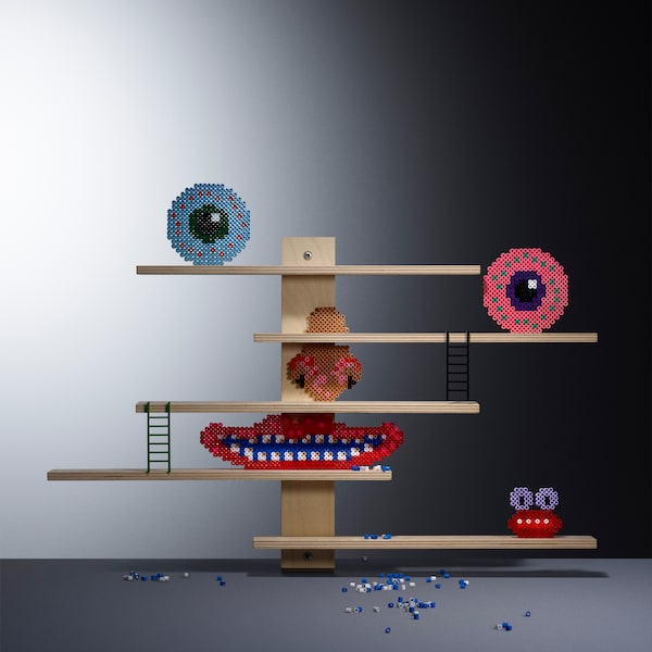 These flexible and multifunctional IKEA LUSTIGT shelves can easily be moved sideways, or used to display favourite toys.