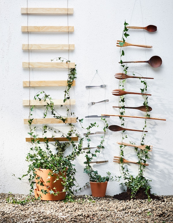 Three DIY trellises are made of bed slats, metal cutlery and wooden kitchen utensils.