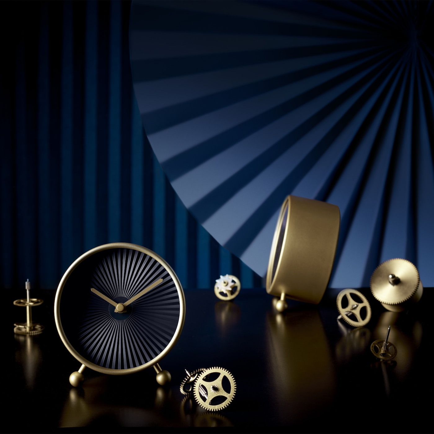 Time is golden with IKEA SNOFSA clock. The brass indicators set against a black clock face add a glimpse of luxury to your bedside table.