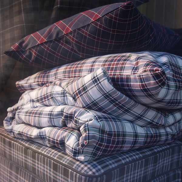 Warm up with this MOSSRUTA quilt cover and two pillowcases chequered in white, red, blue and green. From IKEA, it is made of soft cotton flannel that's brushed and velvety.