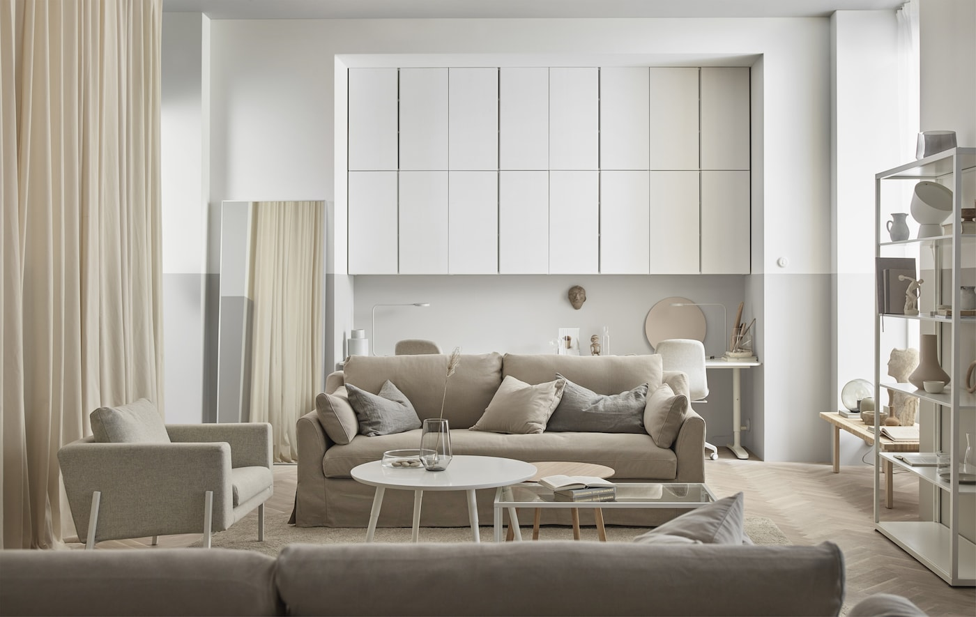 Woods, creamy white, and glass create a relaxing and organic feeling living room.