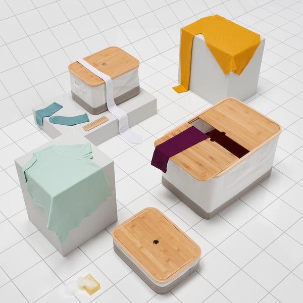 宜家 RABBLA 雷布拉 带格储物盒让你的收纳井井有条。采用可再生的竹制盖子和回收聚酯纤维盒身。可在衣柜内、开放式搁板上或潮湿处使用。